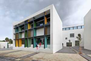 This Tel Aviv School Features a Colorful Facade and White Interior