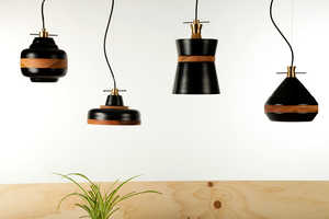 The 'Volta Collection' is a Series of Wood and Metal Dangling Lights