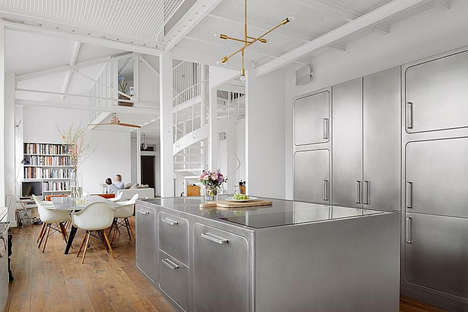 Modernized Retro Kitchens - This Parisian Apartment Boasts Stainless Steel Kitchen Cabinets