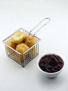 Fried Mashed Potato Bites - This Popular Dish is Served Deep Fried with a Cranberry Ginger Dip
