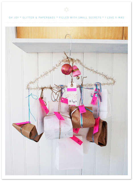 Hanger Advent Calendars - This Homemade Advent Calendar with Presents Recycles a Wire Clothes Hanger
