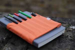 The 'Penroll' Notebook Pen Holder Clips to Pads to Fasten Utensils