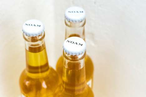 Refined Bavarian Lagers - NOAM is an Artisanal German Beer Served in Italian Glass Bottling