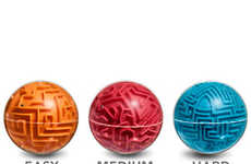 Spherical Maze Brainbusters - The A-Maze-Ball Games Offer Circular Puzzles to Keep the Mind Active