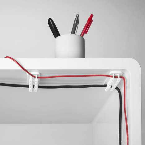 Concealed Cable-Organizers - The Cablox is a Discrete Set of Lugs that Grip Long Cords to Desks