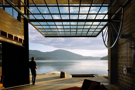 Industrial Lakeside Cabins - This Cabin Features a Hand-Cranked Window Wall That Opens to the Lake