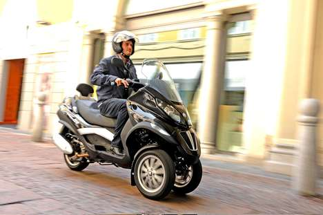 Scooter-Sharing Programs - The Piaggio MP3 is Part of a Vehicle-Sharing Service in Milan