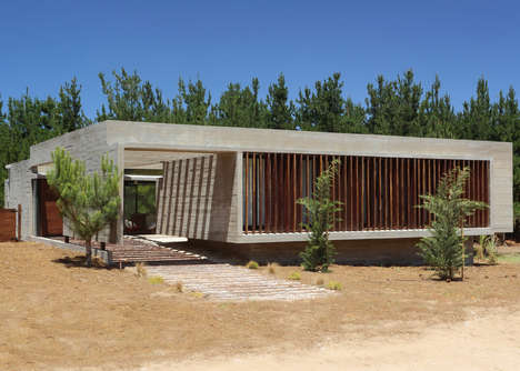 Framed Concrete Holiday Homes - This Home Features Board-Marked Concrete Walls and Wood Detailing