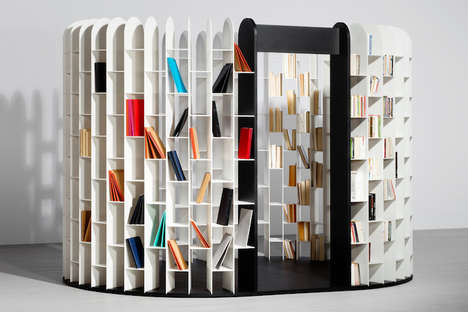 All-Encompassing Bookshelves - Area by Gilles Belley is a Semi-Enclosed Circular Bookcase