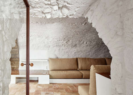Whitewashed Spanish Farmhouses - This Revamped Farmhouse Features Whitewashed Stone and Glazed Tiles