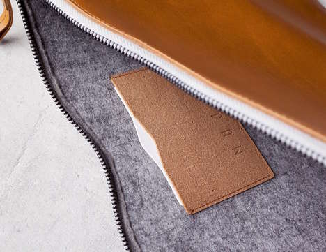 Creative Professional Laptop Protectors - The Mujjo Leather MacBook Folio Sleeve is Meeting-Ready