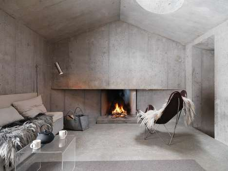 Contemporary Concrete Cottages - This Swiss Alps Home Blends Cozy and Industrial Details