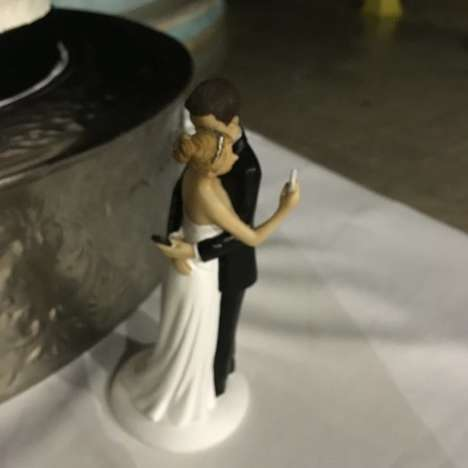 Smartphone-Obsessed Cake Toppers - This Wedding Cake Topper Pokes Fun at Modern Romance