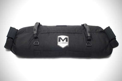 Versatile Weight Training Totes - The Mandown Man Bag is a Workout Prop Filled With Weighted Sand
