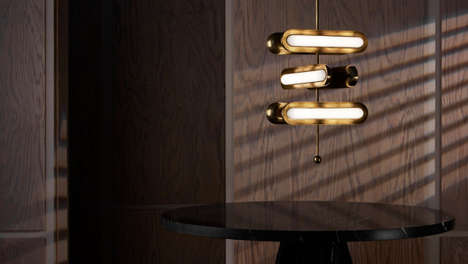 Sculptural Apparatus Lighting - The CIRCUIT and TASSEL Hanging Fixtures Are Made From Brass Capsules
