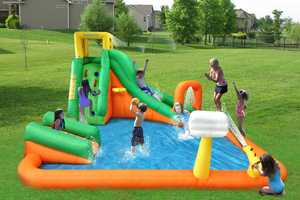 The Magic Time Titan Falls Inflatable Water Slide and Pool is Expansive