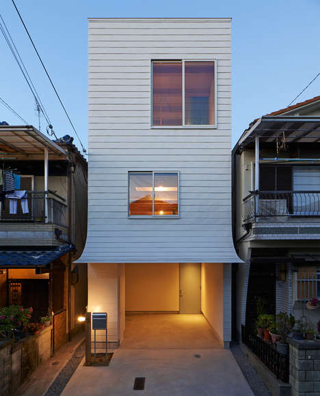Space-Saving Narrow Homes - This Japanese House Narrowly Fits Between Two Traditional Homes