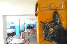 This Parisian Street Artist Stencils Cats onto Walls Around the World