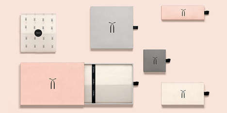 Understated Fashion Branding - Twice Fashion's Brand Identity and Packaging Embodies Femininity