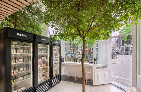 Integrated Forest Juiceries - Cold Pressed Juicery Integrates a Living Tree into the Store Interior