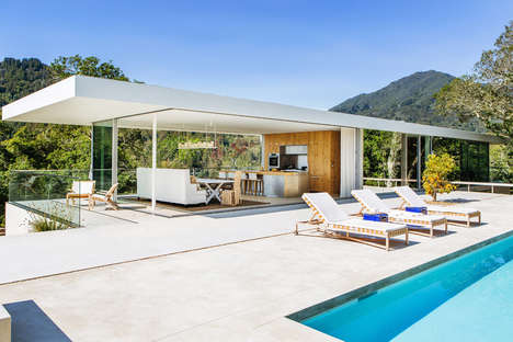 Modern Glass Homes - This Home Uses the Outdoors as Its Main Focal Point