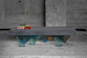 These Unusual Coffee Tables Sit Atop Glass Legs