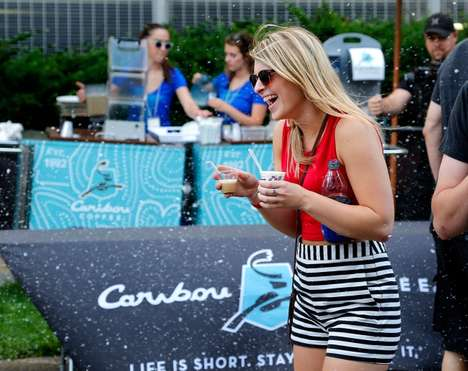 Wintry Festival Campaigns - Caribou Coffee Made It Snow at a Rock Event to Promote Its Iced Drinks