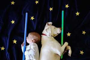 These Photos of a Puppy and Baby Sleeping Show the Soft Side of Rescues