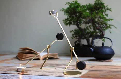 Balancing Candle Scales - The 'Rising Balance' Candlebra Transitions Up as the Candles Melt