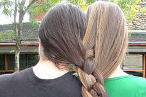 Close Companionship Via Self-Inflicted Conjoined Hairstyles