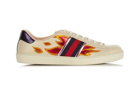Luxe Flame Sneakers - These Gucci Sneakers Feature a Fiery Metallic Design Along with the Brand Logo