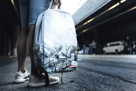 Money-Printed Backpacks - Sprayground Updated Unique Carriers with One That's Covered in Bill Rolls