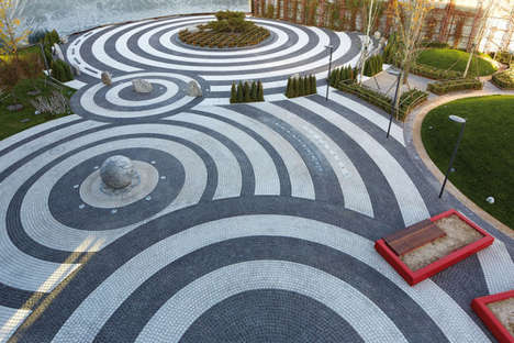 Swirled Pavement Installations - This Contrasted Roadside Stone Arrangement Utilizes Circle Shapes