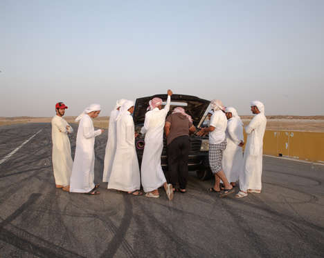 Reckless Racing Game Photography - In 'Hajwalah,' Drivers Attempt to Ride Cars on Two Wheels
