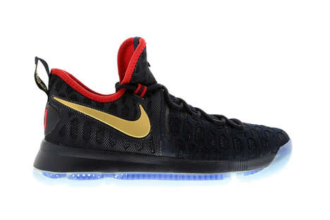 Gold-Branded Basketball Shoes - The Nike Swoosh Logo Was Colored Gold to Commemorate the Rio Games