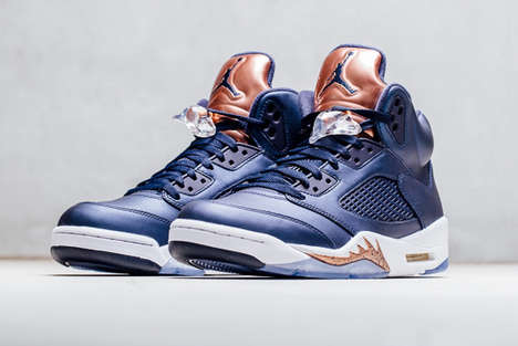 Bronze-Accented Basketball Shoes - These Navy Air Jordan 5s Feature Luxurious Metallic Contrasts