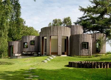 Cylindrical Log Cabins - Jan Henrik Jansen's 'Birkedal' is a Holiday Home in Denmark
