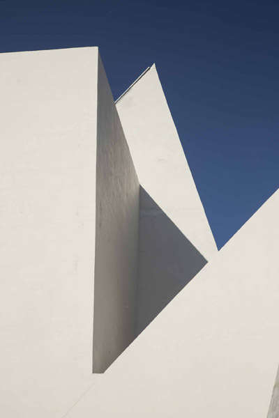 Abstract Modernist Churches - Pueblo Serena Church is a Bright White Series of Angled Volumes