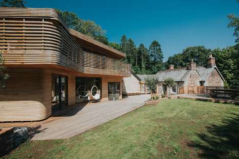 Steam-Bent Wooden Lodges - This Cornish Gamekeeper's Lodge's Facade is Covered in Curving Timber