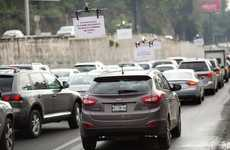 Airborne Drone Ads - UberPool is Advertising to Gridlocked Drivers with Sign-Carrying Drones