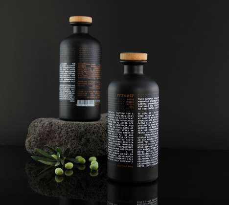 Ancient Typography Oil Bottles - This Olive Oil Packaging Features Writing That is Read Backwards