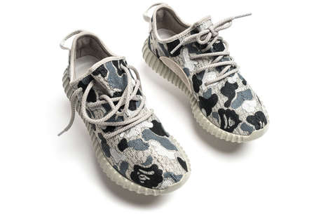 Co-Branded Rapper Sneakers - The New Yeezy Boost 350s Features BAPE's Often-Used Camouflage Pattern