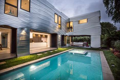 Undulating Metal Facades - 'The Wave House' Features a Hypnotic Wave-Like Cladding
