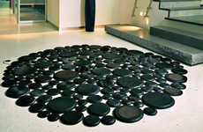 Faux Pebble Floors - Pachamama 'Eclipse' Leather Rugs Look Like River Rocks