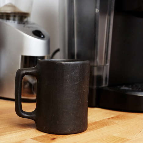 Prehistoric Coffee Mugs - The Caveman Morning Coffee Mug is Made from Serpentine Rock and Clay