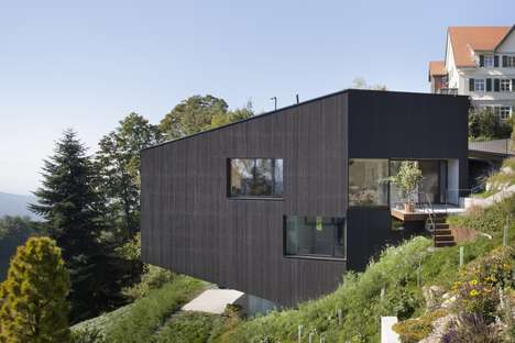 Cantilevered Trapezoidal Houses - 'House Sch' is Built on the Edge of a Steep Precipice