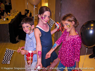 Family Face Painting Companies - Happier Singapore Brings Pro Artists and Glow-in-the-Dark Paint