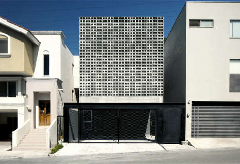 Cinder Block-Clad Houses - Casa 9X20's Facade is Covered in Simple Cement Blocks