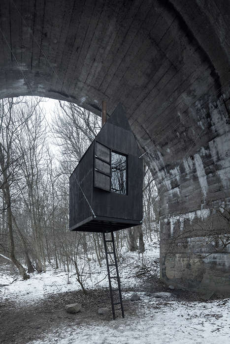 Suspended Mini Homes - The Flying Black House is a Scary Reminder to Live Simply