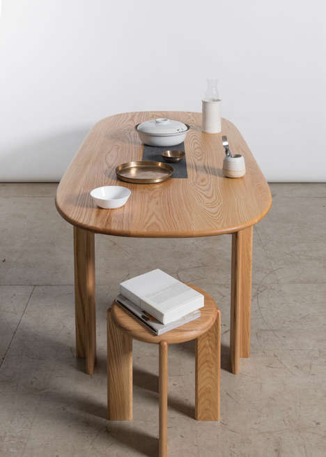 Storage-Embedded Dining Tables - The Miro Dining Table has a Crevasse for Storing Tableware